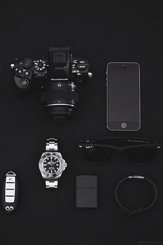 Stylish EDC pocket dump - iPhone, zippo, Ray Ban, Olympus DSLR, Rolex Sea-Dweller Deep Sea