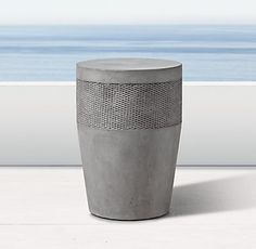 RH's Cosimo Side Table:Inspired by a drum' s primitive form, our side table by Clodagh is defined by its sculptural simplicity. Subtly tapered at the base, the design is unadorned but for a textural crosshatch band that evokes shifting patterns in the sand.
