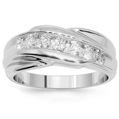 This lovely womens diamond wedding band is crafted in highly polished 14K White Gold. The center is channel set with seven round cut diamonds which total to 0.79 carats. The frame measures to 5/16 Inches in width and weighs approximately 9 grams. This large womens diamond wedding band is an ideal gift for that special someone. $1,379.00