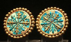 """Moche (Mochica) culture gold ear ornaments Apogee Epoch (100 - 800 AD) Each measures 7.8 cm across Lima: Museo Larco www.museolarco.org/catalogo/ficha.php?id=9196 www.museolarco.org/catalogo/ficha.php?id=9197  This set of gold earrings use turquoise and malachite shells to represent iguanas. Ear ornaments were one of the most significant adornments used to distinguish those individuals in power in Andean societies. When the Spanish arrived they called the Inca nobles """"orejones"""" (literally…"""