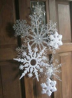 Front door snowflake winter / holiday decor in place of wreath , made with dollar store snowflakes