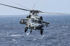 EAST CHINA SEA (March 3, 2015) An MH-60S helicopter assigned to Helicopter Sea Combat (HSC) Squadron 25 takes off from the flight deck of the amphibious dock landing ship USS Ashland (LSD 48). Ashland is underway in the U.S. 7th Fleet area of responsibility. (U.S. Navy photo by Mass Communication Specialist 3rd Class Christian Senyk/Released)