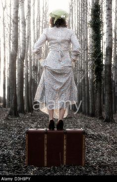 Woman with old suitcase. Vintage