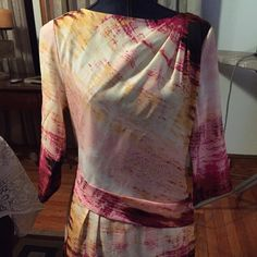 Vincent Camuto multi-colored dress With splashes of yellow, burgundy, pinks and black, this Camuto dress is one of a kind Vince Camuto Dresses