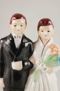 Vintage Bride and Groom Ceramic Cake Topper. $25.00, via Etsy.