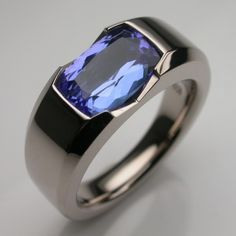 Bespoke Radiant Engagement Ring 18 Carat White Gold & Blue Sapphire.