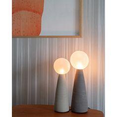 Table lamp made of handmade ceramic base and sandblasted glass ball/ isabel hamm licht