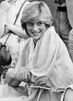 One of Sun royal photographer Arthur Edwards' favourite photos of Princess Diana, watching Prince Charles play a polo match in 1982