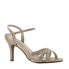 b4b7e45fe The Touch Ups Dulce Champagne is a metallic shimmer sandal. The front criss  cross straps covered with rhinestones. The Dulce Champagne is available in  size ...