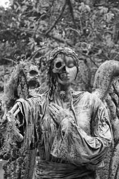 Halloween Cemetery Statue, half angel, half skeleton (We were informed this is not real, but a Halloween prop., sure does look like it though). http://www.thefuneralsource.org/cemeteries.html
