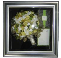Custom made shadowboxes can keep your wedding memories alive!  Preserve your flowers with TimelessMoments.com and find out how easy it is to create a beautiful keepsake from your bouquet.