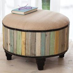 Barnwood Ottoman:  Spacious, comfy, with surprising details: ziggurat feet, nail-studded faux-leather trim. Sides are wood slats washed with soft colors and gently distressed; top is linen over thick foam padding. Sturdy wood frame.   http://acacialifestyle.com/barnwood-ottoman/p/54904/home-link/