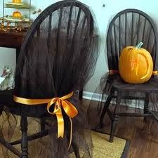 gothic party decoration ideas . I like the idea of black tulle over the chairs with purple ribbon around instead of the orange.