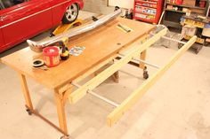 Great idea for a workbench.  When ripping plywood, 2x4's extend on metal conduit to support cut offs.