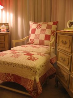 ...<3...footstool and chair recovered with old quilts :~)
