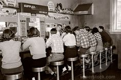 1950s Soda Shop | ... Teens Sitting Together At A Soda Fountain Malt Shop Counter Snack Food