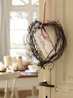 A charming, rustic little twig heart wreath.