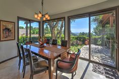 Staged to Sell. This one of a kind zen style home will take your breath away. Dining room leading out to lush green landscaping and a tropical backyard where you can enjoy your own private jacuzzi or fire pit.