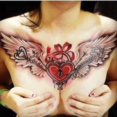 Heart locket with angel wings. A gallery of sexy female chest tattoos.