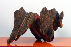 """""""the monsters"""" (the spirit of the beehive)...coloured Staedtler pencils, epoxy and linseed oil...42 x 77 x 46cm  ~  Lionel Bawden"""