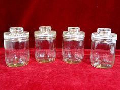 19) Good matching set of four vintage glass storage jars Est. £10-£15