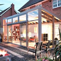 I love this idea for a sunroom extention off of the kitchen or conservatory.