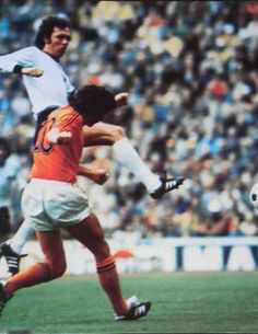 West Germany 2 Holland 1 in 1974 in Munich. Franz Beckenbuer clears from Wim Suurbier in the World Cup Final.