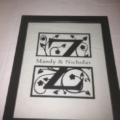 Split letter with Annabel font, in vinyl on glass, frame from target.
