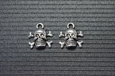 Hey, I found this really awesome Etsy listing at https://www.etsy.com/listing/191519770/20pcs-cross-bone-skull-charms-halloween