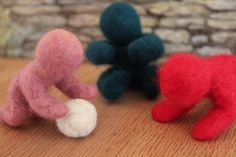 Three Felt Babies and a Ball by thefeltexperience on Etsy, $30.00