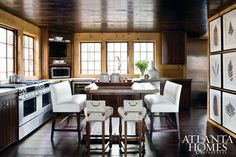 Lakehouse kitchen designed by Susan Ferrier. Love the seating!