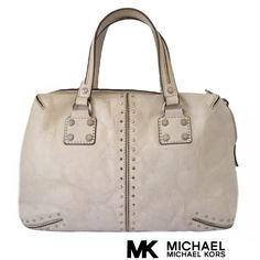 """Michael Kors leather handbag Beautiful 100% authentic Michael Kors bone color leather handbag, in a good preloved condition, has small normal sings of wear, no tear or stain inside and outside. Straps are good. The leather in this bag is like vintage distressed look. Dust bag include.  Measures Approx. 14.5"""" at widest X 7"""" long, depth 4"""" Straps drops 7"""". Michael Kors Bags"""
