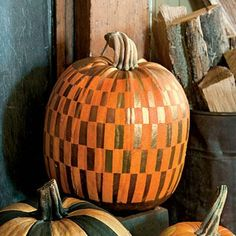Painted Pumpkins | Go for a mod look with a gold rectangle pattern. Then group painted pumpkins by the fireplace for added shimmer. | SouthernLiving.com