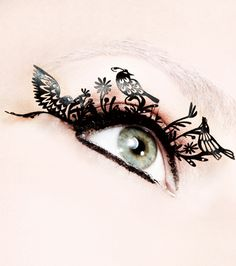 This makes me want to brush up on my tiny cutting skills and makes eyelashes out of paper!    Google Image Result for http://www.nonesuchthings.com/static/images/productimage-picture-paper-eyelashes-bird-298.500