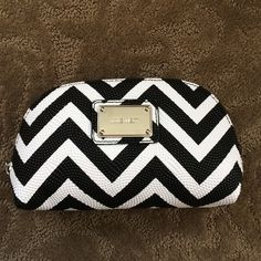 NWP Nine West cosmetic pouch NEVER USED. NO TAG BUT STUFFING INSIDE. Fun print and material. Please only inquire if seriously interested. Nine West Bags Cosmetic Bags & Cases