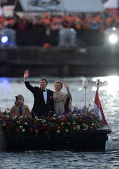 (R-L) Queen Maxima, King Willem-Alexander of the Netherlands and daughter Princess Alexia wave on a boat as they take part in a water pageant on the river IJ in Amsterdam