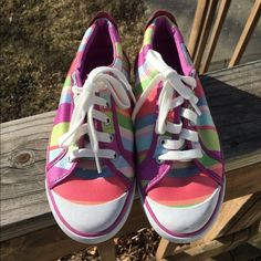 Pink Striped Coach Sneakers!!  NWOT these shoes were a display item. Some dirt/scuff/smudge (typical of rubber tie sneakers) on left toe. Gorgeous otherwise!! Coach Shoes Sneakers