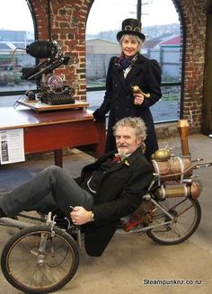 (steampunk tricycle) Helen Jansen and Iain Clark Steampunk Men, Steampunk Dress, Steampunk House, Steampunk Cosplay, Steampunk Fashion, Fantasy Play, Steampunk Characters, Steampunk Accessories, Retro Futuristic