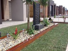 Image from http://media.truelocal.com.au/7/6/7AB5E9BA-F120-441E-91C2-39EE8E42B366/exseed-landscaping-1-eden-landscaping-merbau-planter-box-water-feature-turf-pebbles-bd4f-938x704.jpg.