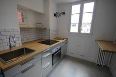 Cuisine / inox / bois / carreaux métro / appartement / années 30 / fonctionnelle / petit prix - MMCC Architecture http://www.mmcc-architecture.com/