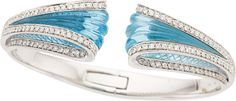 Blue Topaz, Diamond, White Gold Bracelet, Io Si The hinged bangle from the Scavia Collection features carved blue topaz, enhanced by full-cu...