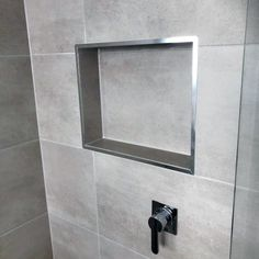 Stone Tiles With Stainless Steel Trim Impressive Shower Niche Ideas Tile Shower Niche, Shower Alcove, Bathroom Niche, Small Bathroom, Bathroom Canvas, Concrete Bathroom, White Bathrooms, Bathroom Showers, Luxury Bathrooms