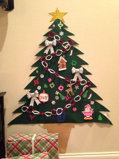 Our toddler friendly Christmas tree made from felt and decorated with foam stickers and foam ornaments with Velcro on the back.