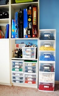 Possible Lego storage solution. Do I really want to sort all those out (and expect my boys to actually do it at clean up time as well) by color? I do like the idea of just dumping all the Star Wars sets into one bin. Could store all the instructions in a binder for A & T's reference.