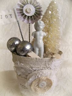 Handmade Winter White Christmas Decoration Vintage Christmas Decor Shabby White Peat Pot Vintage Frozen Charlotte Altered Pot by QueenBe on Etsy https://www.etsy.com/listing/168273173/handmade-winter-white-christmas