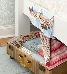 Rolling Under-Bed Storage Repurpose an old, battered suitcase for storage underneath your bed. Remove a damaged half from a flea-market suitcase to create an open drawer and add casters to make it conveniently mobile. Stitch up a pretty fabric cover and attach to the suitcase edge with Velcro to keep your stored contents dust-bunny free.
