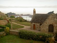 *Ploumanac'h* ~a village in the town of Perros-Guirec the department of Cotes d'Armor, in the region Brittany in France. [Pictured: a view of the Chapel St Guirec, the beach & the Chateau de ploumanac'h Costaérès Castle in the background.] |Photo by ~emwan~|