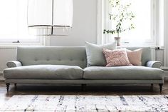 A sofa long enough for everyone! Grey with pastel pillows