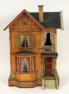 dollhouse with lace curtains..