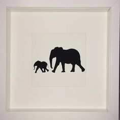 Silhouette Paper Cut-out of an Elephant and Calf in White Box Frame. Available from our website and Etsy. #elephant #blackandwhite #art #motherandbaby #framedart #calf #baby #madeinengland #unique #bespokeart #bespoke #parenting #parent #gift #present #elephants #mothersday #love #etsy